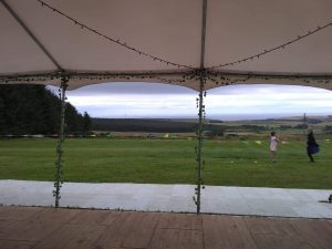 view looking out of marquee in a field
