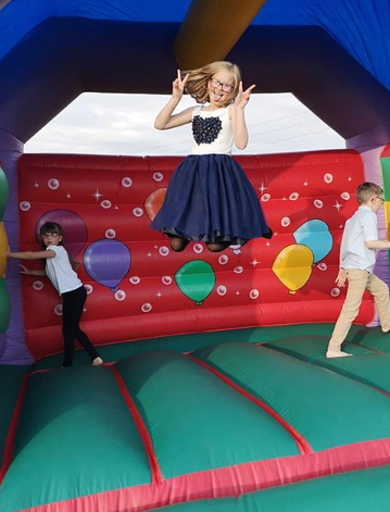 children playing on a colourful bouncy castle