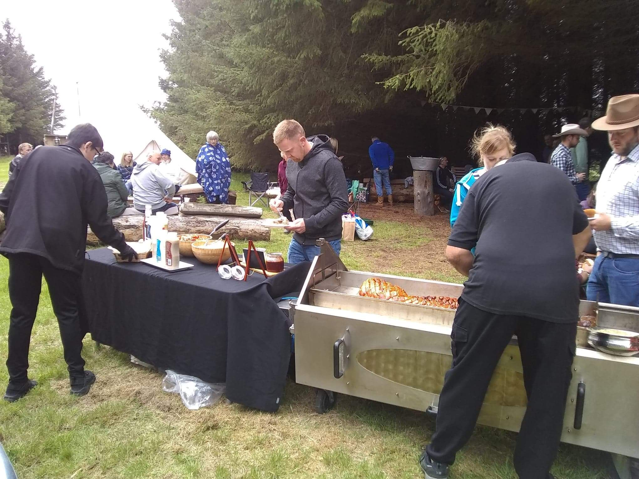 hog roast being served in our woodland clearing at an informal party