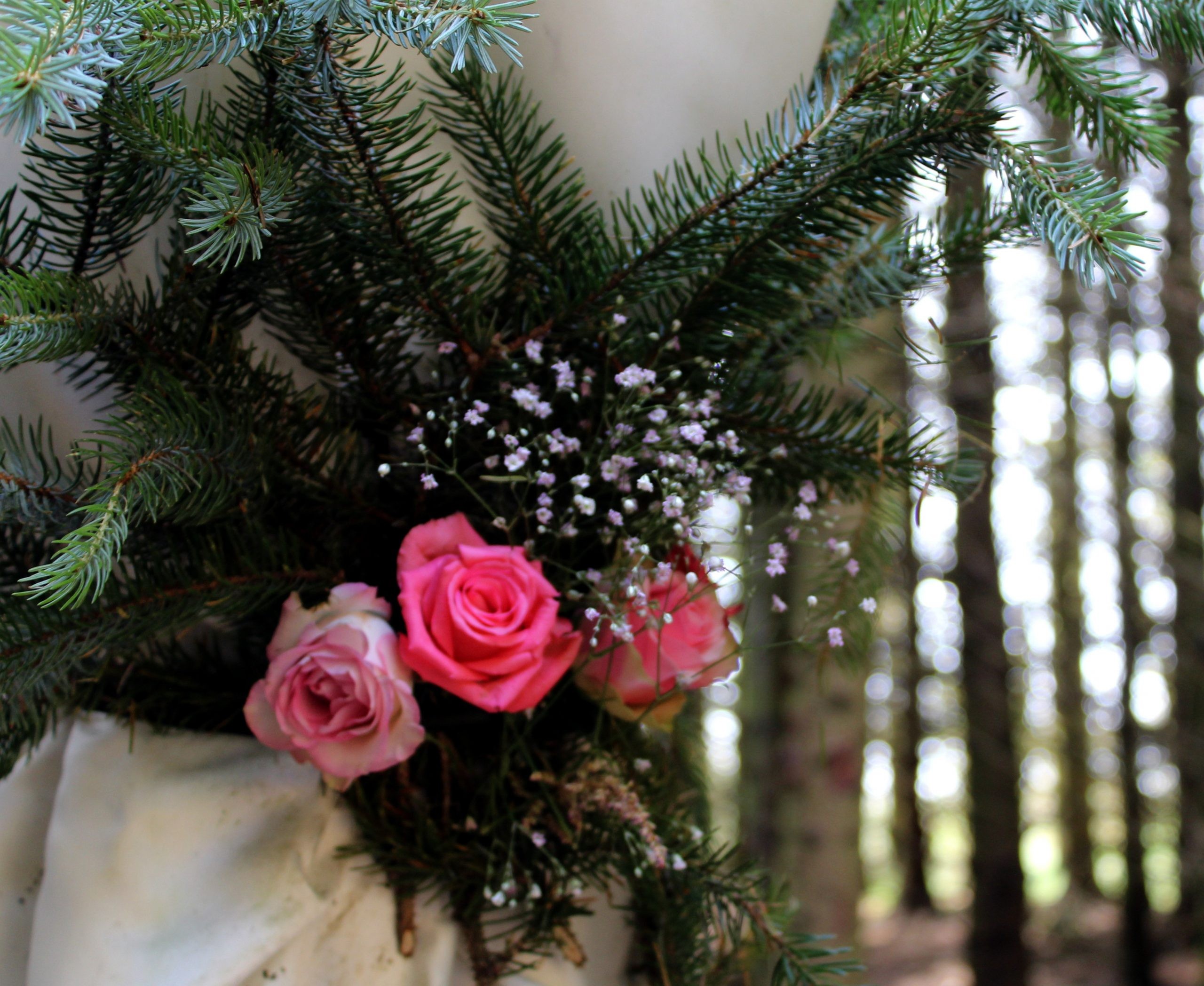 stunning pink rose bouquet decoration on solid wood arch in our woodland cathedral