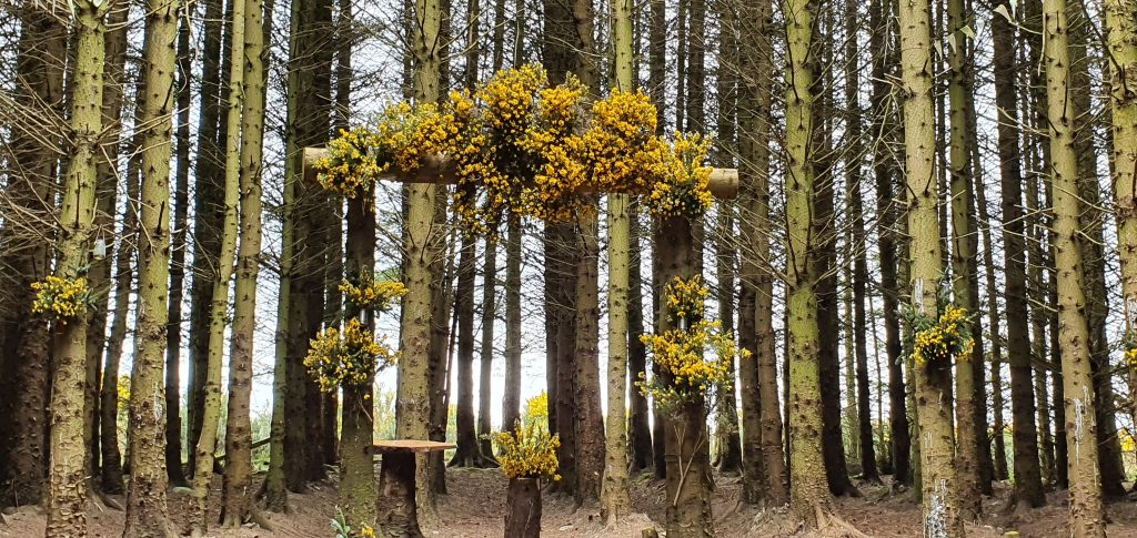 beautifully decorated solid log arch in our Woodland Cathedral festooned with flowers