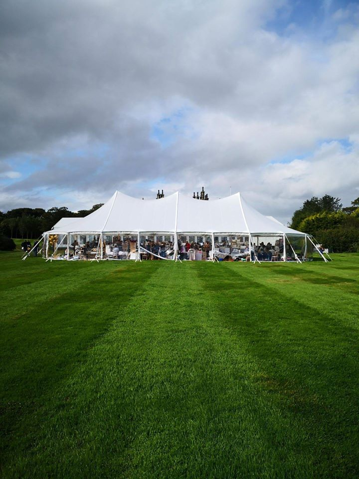 view of exterior of marquee in a field