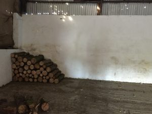 starting to build a feature log wall in wedding barn