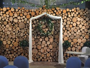 close up view of unique solid log feature wall