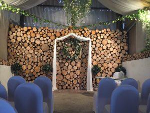 inside our rustic wedding barn with a solid log feature wall which is 3m thick and smells divine